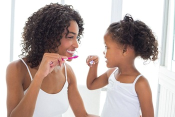 mom and daughter brushing