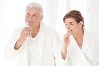 Senior couple brushing teeth