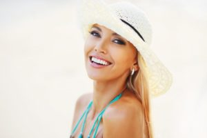 vacationing woman with white teeth