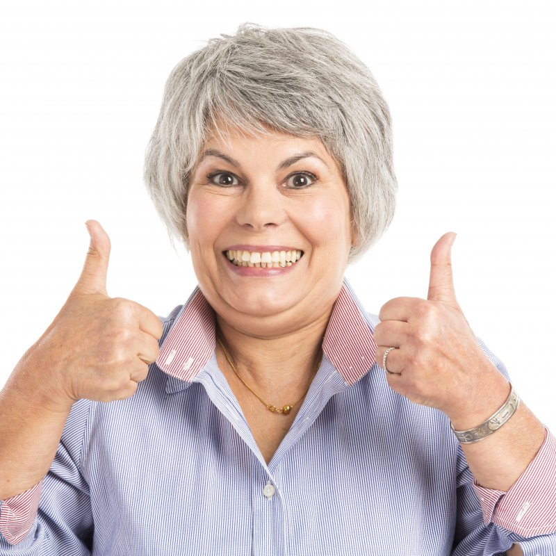 older woman smiling with complete smile
