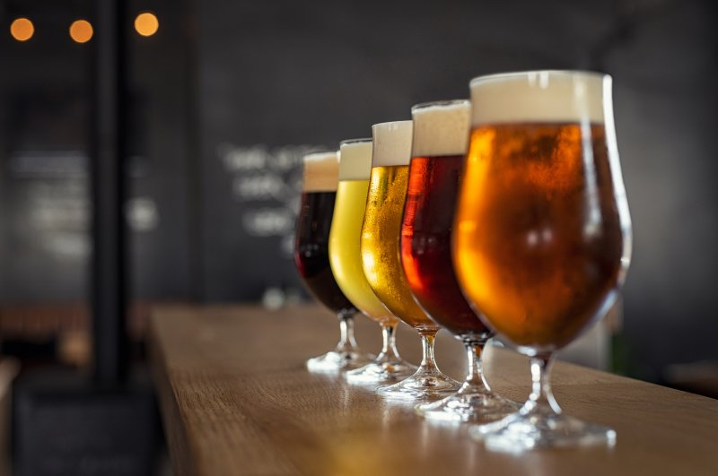 Several glasses of beer in a row